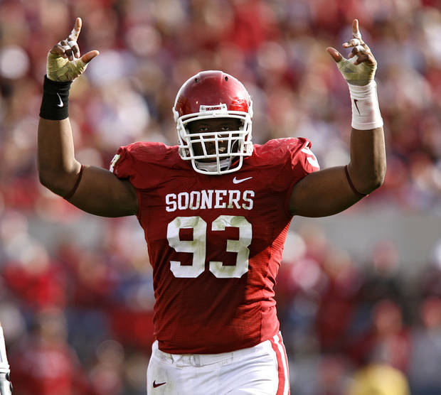 photo - Oklahoma's Gerald McCoy (93) pumps up the crowd during the second half of the Sooners' 33-7 victory over Baylor Saturday at at Gaylord Family-Oklahoma Memorial Stadium in Norman. Photo by Chris Landsberger, The Oklahoman.
