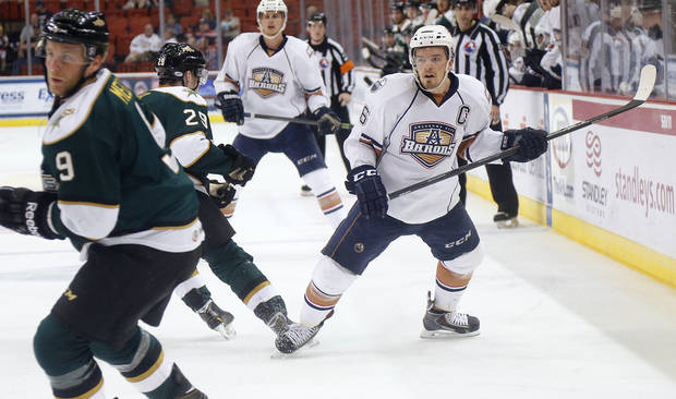 photo - Oklahoma City's Anton Lander (16) tries to set up the offense during the Oklahoma City Barons first-round AHL playoff game against the Texas Stars on Wednesday, April 23, 2014, at the Cox Convention Center in Oklahoma City, Okla.    Photo by Chris Landsberger, The Oklahoman