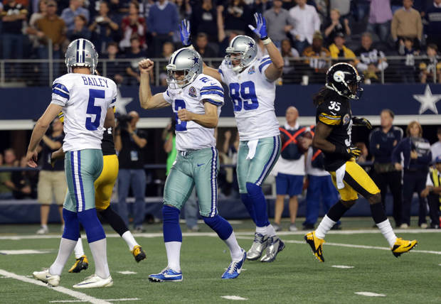 photo - Dallas Cowboys punter Brian Moorman (2) and John Phillips (89) celebrate after kicker Dan Bailey (5) kicked a field goal to beat the Pittsburgh Steelers 27-24 in overtime of an NFL football game Sunday, Dec. 16, 2012 in Arlington, Texas. Pittsburgh Steelers&#039; Josh Victorian (35) leaves the field. (AP Photo/LM Otero)  ORG XMIT: CBS145
