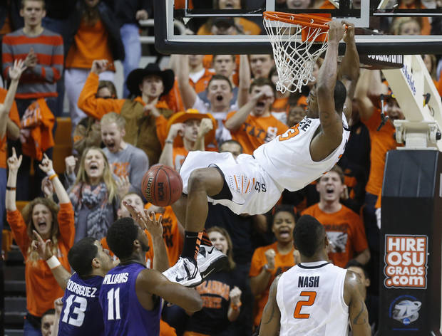 photo - Oklahoma State guard Marcus Smart (33) dunks in front of Kansas State guard Angel Rodriguez (13) and forward Nino Williams (11) and Oklahoma State's Le'Bryan Nash (2) in the second half of an NCAA college basketball game in Stillwater, Okla., Saturday, March 9, 2013. Oklahoma State won 76-70. (AP Photo/Sue Ogrocki)