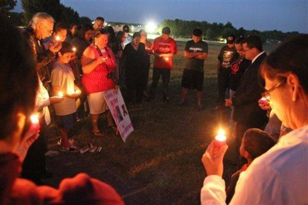 photo - Cherokee Nation Attorney General Todd Hembree (far right) prays with supporters of the Dusten Brown family on Monday evening, Sept. 23, 2013 in Tahlequah, Okla., after announcing that Veronica Brown had been turned over to her adoptive parents. The transfer came hours after the  Oklahoma Supreme Court dissolved a temporary court order that had kept the child in the Cherokee Nation with her father and his family. Supporters of Brown, the girl's biological father, say he put up a hard-fought battle for the right to keep Veronica but that he