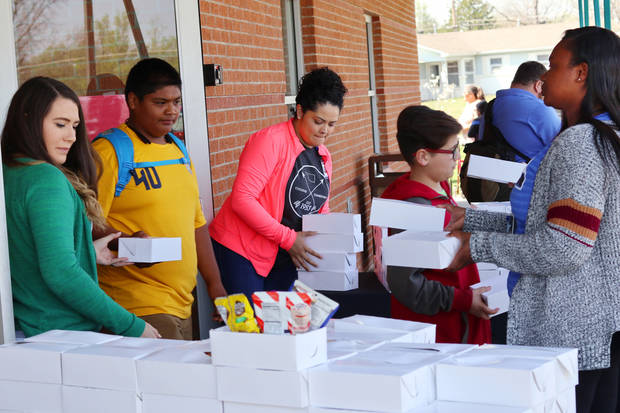 Food boxes provided by Feed the Children, is given to students at Hillcrest Elementary in south Oklahoman City Friday, March 30, 2018. Photo by Doug Hoke, The Oklahoman