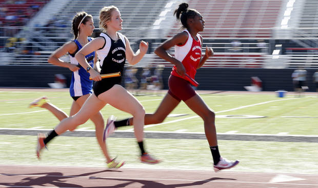 photo - Runners compete in the girls 3,200 meter-relay during the Meet of Champions at Yukon High School on Tuesday, May 14, 2013. Photo by Bryan Terry, The Oklahoman