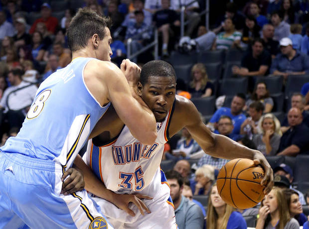 photo - Oklahoma City's Kevin Durant (35) tries to get around Denver's Danilo Gallinari (8) during the NBA preseason basketball game between the Oklahoma City Thunder and the Denver Nuggets at the Chesapeake Energy Arena, Sunday, Oct. 21, 2012. Photo by Sarah Phipps, The Oklahoman