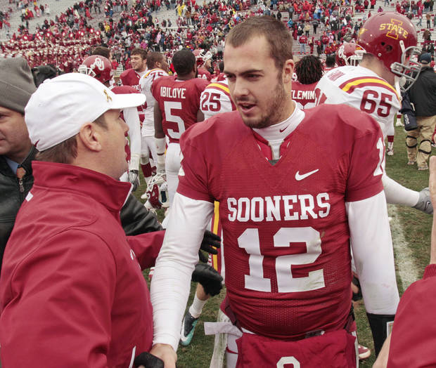 photo - Sooner head coach Bob Stoops congratulates quarterback Landry Jones after a college football game in which  the University of Oklahoma Sooners (OU) defeated the Iowa State University Cyclones (ISU) 26-6 at Gaylord Family-Oklahoma Memorial Stadium in Norman, Okla., Saturday, Nov. 26, 2011. Photo by Steve Sisney, The Oklahoman