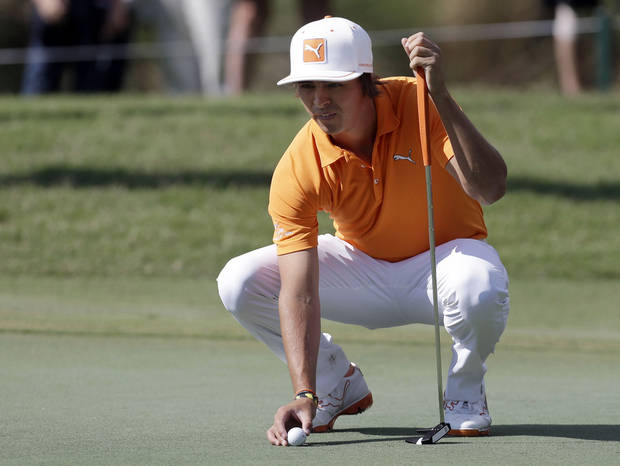 photo - Rickie Fowler lines up a putt on the sixth green during a practice round at The Players Championship golf tournament at TPC Sawgrass in Ponte Vedra Beach, Fla., Tuesday, May 7, 2013. (AP Photo/Gerald Herbert) ORG XMIT: FLGH108