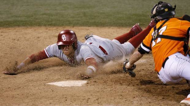 photo - OU's Hector Lorenzana slides home past OSU's Gage Green in the 18th inning of a Bedlam baseball game between Oklahoma State University and the University of Oklahoma in Stillwater, Tuesday, April 15, 2014. Photo by Bryan Terry, The Oklahoman