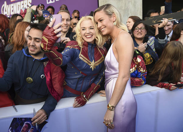 "Brie Larson takes a selfie with a fan as she arrives at the premiere of ""Avengers: Endgame"" at the Los Angeles Convention Center on Monday, April 22, 2019. [Photo by Chris Pizzello/Invision/AP]"