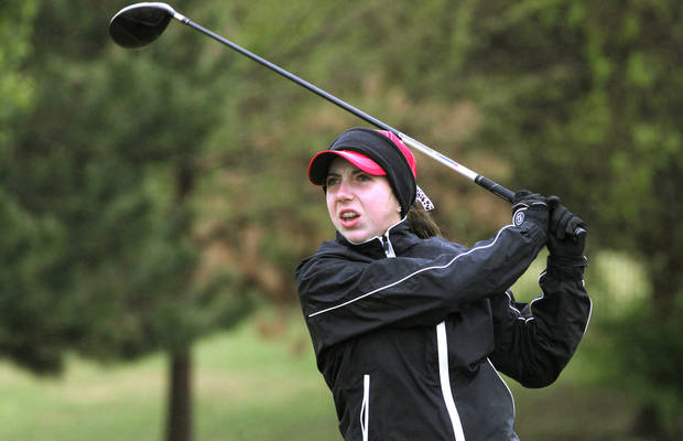 photo - Tulsa Union's Trudy Allen tees off during the second day of Girls 6A golf tournament, Thursday, May 2, 2013. The players that tied yesterday play in a playoff due to the rain. Photo By David McDaniel/The Oklahoman