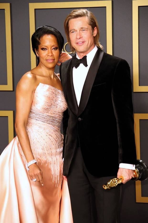 "Regina King, left, poses with Brad Pitt, winner of the award for best performance by an actor in a supporting role for ""Once Upon a Time in Hollywood,"" in the press room during the 92nd Academy Awards at Dolby Theatre. [Dan MacMedan/USA TODAY]"