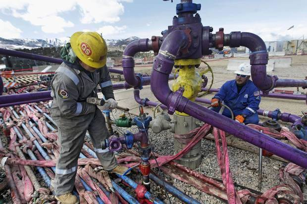 photo -  Workers tend to a well head in March 2013 during a hydraulic fracturing operation at an Encana Oil & Gas Inc. gas well in western Colorado. AP File Photos    -  AP file photo