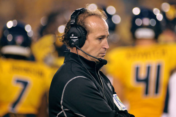 photo - West Virginia coach Dana Holgorsen looks on during the fourth quarter of a NCAA football game against LSU, Saturday, Sept. 24, 2011, in Morgantown, W.Va. (AP Photo/Jeff Gentner) ORG XMIT: WVJG117