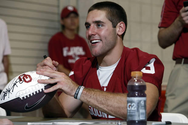 photo - Quarterback Trevor Knight signs an autograph during Meet the Sooners Day on Aug. 3.  Photo by Steve Sisney, The Oklahoman