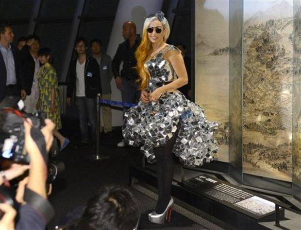 photo - Lady Gaga poses as she visits the Tokyo Sky Tree, the world's tallest freestanding broadcast structure that stands 634-meter (2,080 feet), in Tokyo Tuesday, May 15, 2012. Lady Gaga might have to cancel her sold-out show in Indonesia because Islamic hard-liners and conservative lawmakers objected. National police spokesman Boy Rafli Amar said the permit was denied for the June 3, 2012,