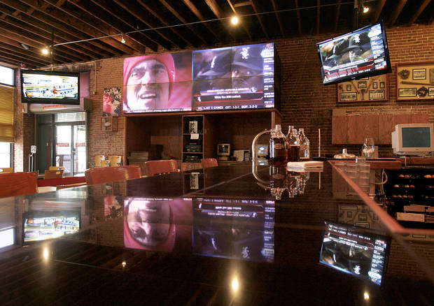 photo - Coach's Brewhouse in downtown Norman will be one of the places where University of Oklahoma football fans get together to watch tonight's 2009 FedEx BCS National Championship Game, when OU takes on University of Florida in Miami. PHOTOS BY STEVE SISNEY, THE OKLAHOMAN