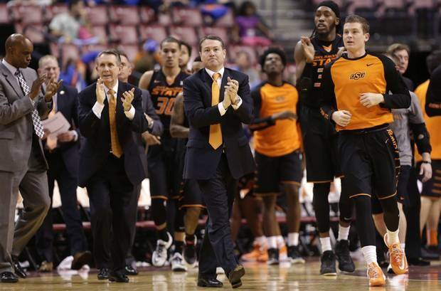 Oklahoma State head coach Travis Ford, center, watches the action in the first half of the NCAA college Orange Bowl Basketball Classic against Florida State, Saturday, Dec. 19, 2015, in Sunrise, Fla. (AP Photo/Lynne Sladky)