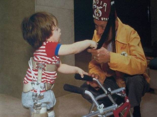 "Members of the OKC India Shriners said getting children to smile is the ""pay"" for their volunteer work. Photo provided by OKC India Shriners."