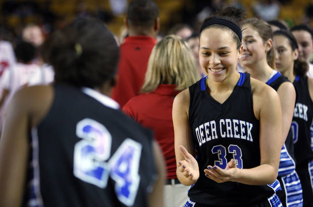 photo - Edmond Deer Creek's Ashley Gibson (right) celebrates after their playoff win against East Central, at the Mabee Center, in Tulsa, on Friday, March 8, 2013. CORY YOUNG/Tulsa World