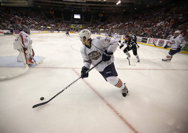 photo - AHL HOCKEY: Oklahoma City's Colten Teubert (33) skates during a game between the Oklahoma City Barons and the San Antonio Rampage at the Cox Convention Center in Oklahoma City, Friday, Oct. 19, 2012.  Photo by Garett Fisbeck, The Oklahoman