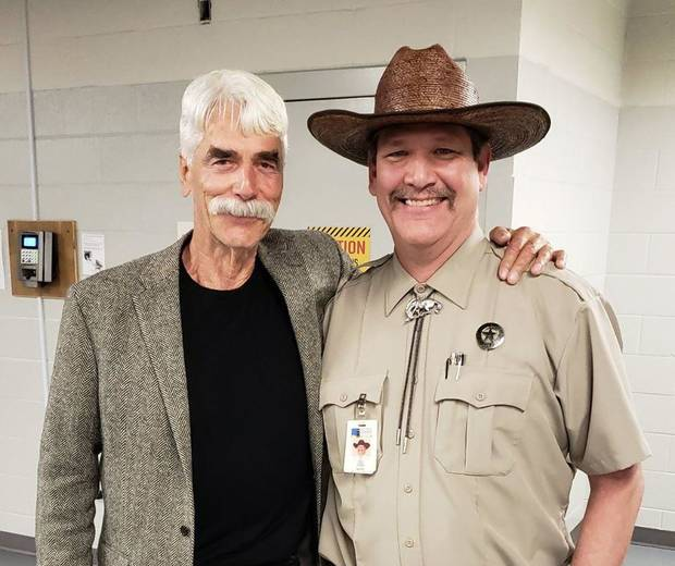 Tim, right, poses for a photo with Sam Elliott in 2019 at the National Cowboy & Western Heritage Museum. [Photo provided]