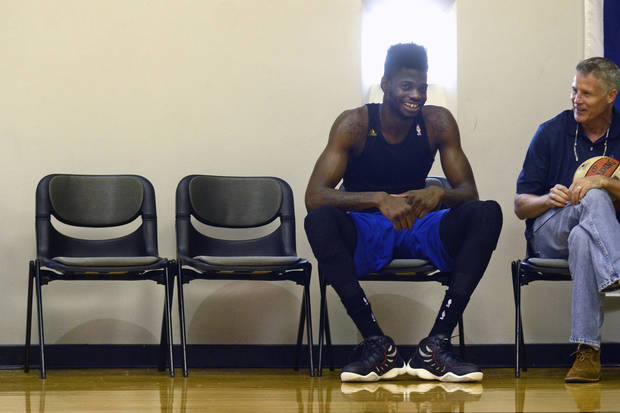 photo - Philadelphia 76ers returning player Nerlens Noel talks with coach Brett Brown, right, during practice, Wednesday July 2, 2014 in Philadelphia. (AP Photo/The Philadelphia Inquirer, Tom Gralish)