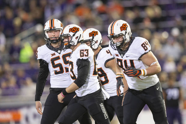 Oklahoma State punter Matt Hockett, far left, had quite a game Saturday vs. TCU. [PHOTO BY BRUCE WATERFIELD, Courtesy OSU Athletics]