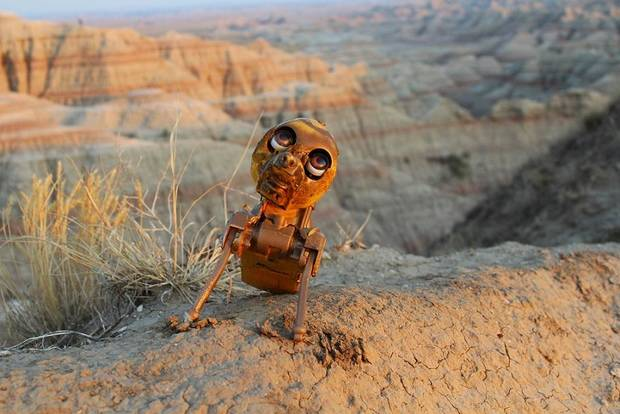 """That's Neither Here Nor There,"" a repurposed animatronic art toy created by Oklahoma City-based artist Allin KHG is pictured in Badlands National Park in South Dakota. The toy's owners, Oklahoma City husband-and-wife musicians Allan and Barb Vest, featured several of the artist's unusual toys in the music video for ""What You Deserve,"" a song by their band doubleVee. Photo provided"