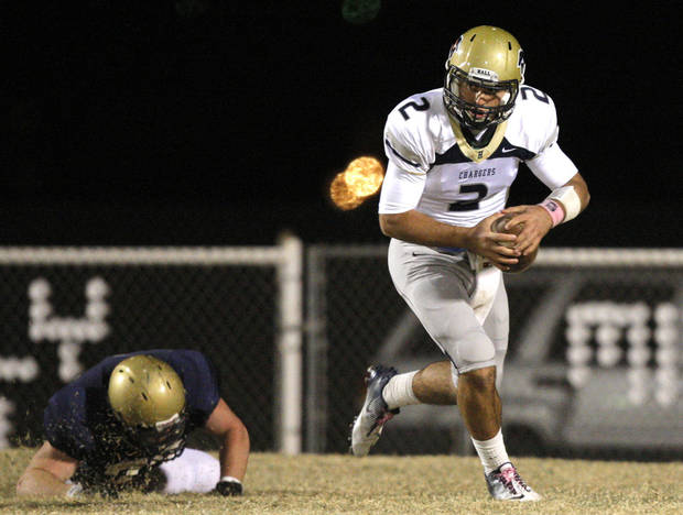 photo - Heritage Hall's Quinn Shanbour scrambles during the high school football game between Kingfisher and Heritage Hall in Kingfisher, Okla.,  Friday, Nov. 4, 2011. Photo by Sarah Phipps, The Oklahoman  ORG XMIT: KOD