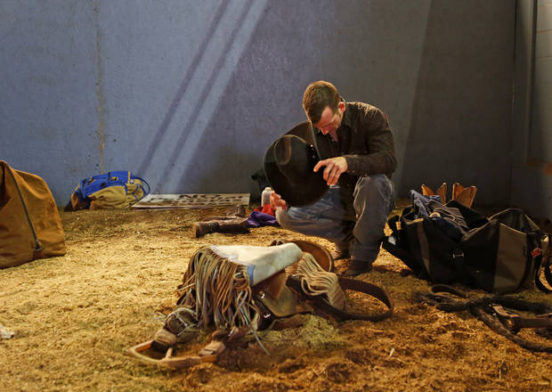 photo - Chad Alesky of Monroeton, Pa., prays before the start of the National Circuit Finals Rodeo at the State Fair Arena, Saturday, April 6, 2013. Photo by Bryan Terry, The Oklahoman