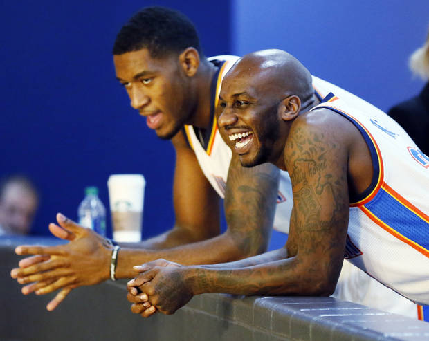photo - Walker Russell, right, laughs with Perry Jones while waiting for their next interview during media day for the Oklahoma City Thunder NBA basketball team at the Thunder Events Center in Oklahoma City, Monday, Oct. 1, 2012.  Photo by Nate Billings, The Oklahoman