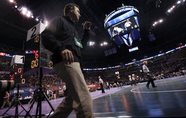 photo - Oklahoma State coach John Smith goes between matches during the 2014 NCAA Div. 1 Wrestling Championships at Chesapeake Energy Arena in Oklahoma City, Okla. on Thursday, March 20, 2014. Photo by Chris Landsberger, The Oklahoman