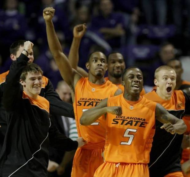 Oklahoma State players celebrate after upsetting tenth-ranked Kansas State in an NCAA college basketball game Saturday, Jan. 23, 2010 in Manhattan, Kan. Oklahoma State won the game 73-69. (AP Photo/Charlie Riedel)