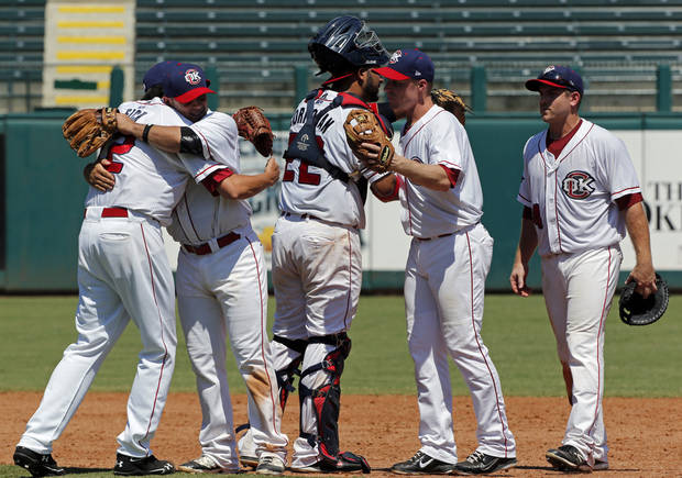 photo - MINOR LEAGUE BASEBALL: Oklahoma City RedHawks players hug after defeating The Round Rock Express 1-0 in their final, regular-season game at the Chickasaw Bricktown Ballpark on Monday, Sept. 3, 2012 in Oklahoma City, Okla.  Photo by Steve Sisney, The Oklahoman