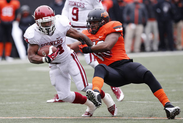 photo - Bowl wins, or even strong performances, by Oklahoma and Oklahoma State can help the national perception of the Big 12. (AP Photo/Sue Ogrocki)