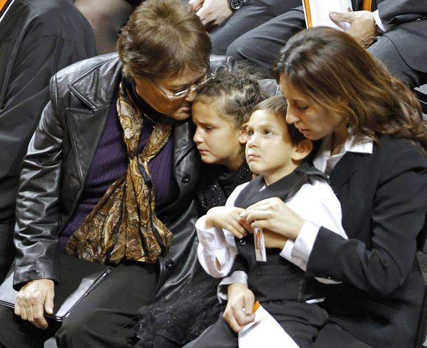 photo - Miranda Serna's mother Nettie Herrera, left, and sister, Cassandra look on during the memorial service for Oklahoma State head basketball coach Kurt Budke and assistant coach Miranda Serna at Gallagher-Iba Arena on Monday, Nov. 21, 2011 in Stillwater, Okla. The two were killed in a plane crash along with former state senator Olin Branstetter and his wife Paula while on a recruiting trip in central Arkansas last . Photo by Chris Landsberger, The Oklahoman