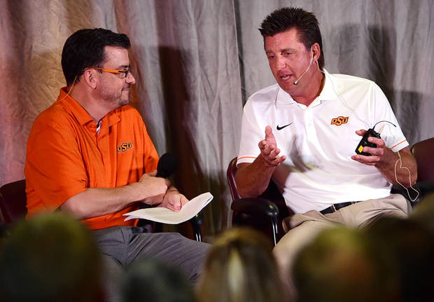 Oklahoma State football coach Mike Gundy discusses the state of the Cowboys last August in Oklahoma City with public address announcer Larry Reece at the Cowboy Caravan. Photo by Tyler Drabek, for The Oklahoman.