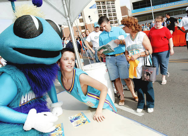 photo - Hugo the Hornet The Hornets' mascot, like most, makes many public appearances on behalf of the team.  Photo By John Clanton, The Oklahoman Archive