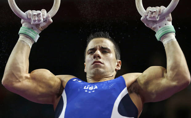 photo - Jacob Dalton, of the United States, performs on the rings during the American Cup gymnastics competition in Worcester, Mass., Saturday, March 2, 2013. (AP Photo/Charles Krupa)