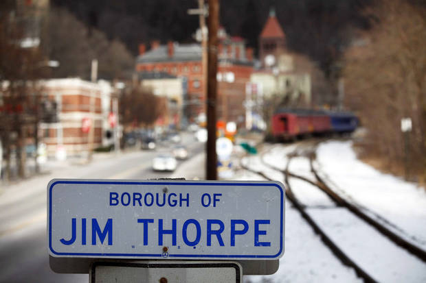 In this 2010 photo, a sign in the town of Jim Thorpe, Pa., is shown.