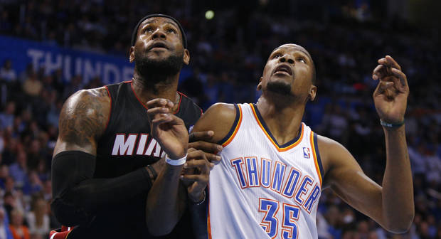 photo - The Thunder's Kevin Durant, right, is drawing the assignment of stopping opponents' top players, like Miami's LeBron James, left.                    Photo by Bryan Terry, The Oklahoman