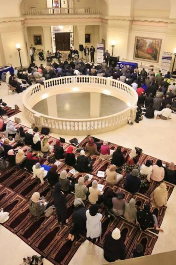 "Oklahoma Muslims pray in the rotunda of the State Capitol during the 2016 ""Muslim Day at the Capitol. [Oklahoman Archives]"