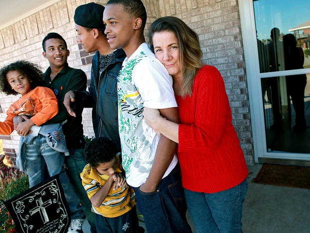 photo - Contessa Bass and sons Tobias, Thomas, Tony, Titus and Terrance Jones, from left, stand outside their new Edmond home. Get more Thanksgiving coverage on Pages 8A, 12A, 13A and 16A. PHOTO BY JOHN CLANTON, THE OKLAHOMAN