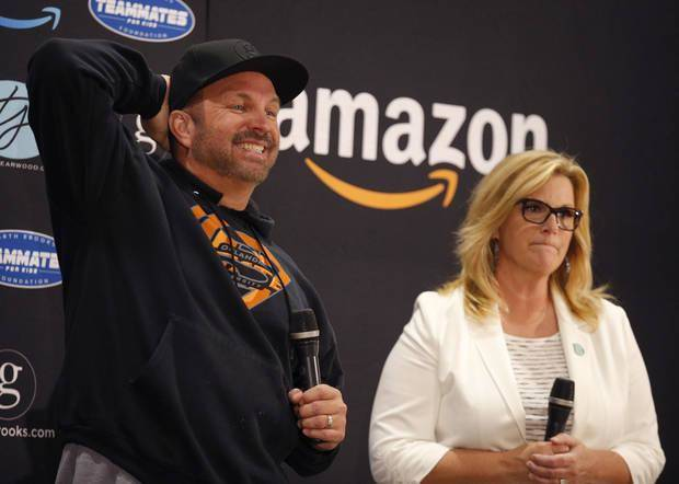 Garth Brooks and Trisha Yearwood speak to the media Friday during a news conference at the Chesapeake Energy Arena in Oklahoma City. Photo by Sarah Phipps, The Oklahoman