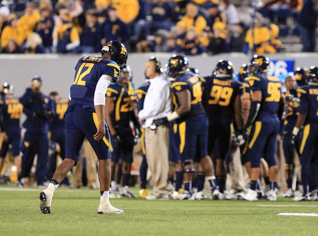 photo - West Virginia quarterback Geno Smith walks off the field after a turnover on downs during an NCAA college football game against Kansas State in Morgantown, W.Va., Saturday, Oct. 20, 2012. Kansas State won 55-14. (AP Photo/Christopher Jackson)   ORG XMIT: WVCJ120