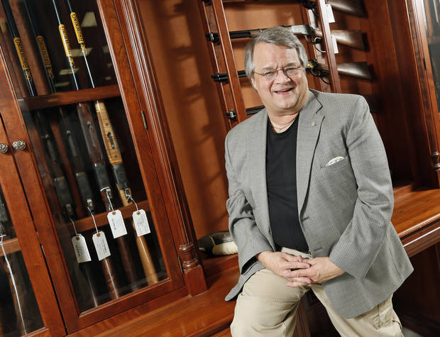 photo - Miles Hall, co-owner of H&H Shooting Sports Complex, poses for a photo at his store, 400 S Vermont Avenue, Suite 110, in Oklahoma City, Wednesday, July 17, 2013. Photo by Nate Billings, The Oklahoman