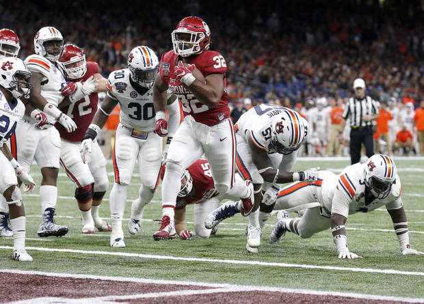 Oklahoma's Samaje Perine (32) scores a touchdown in the fourth quarter during the Allstate Sugar Bowl between University of Oklahoma Sooners (OU) and Auburn University Tigers at the Mercedes-Benz Superdome in New Orleans, Monday, Jan. 2, 2017.  Photo by Sarah Phipps, The Oklahoman