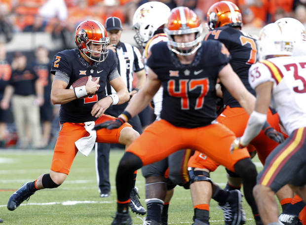 Oklahoma State's Mason Rudolph (2) kneels down in the final minutes during a college football game between the Oklahoma State University Cowboys (OSU) and the Iowa State University at Boone Pickens Stadium in Stillwater, Okla., Saturday, Oct. 8, 2016. Photo by Sarah Phipps, The Oklahoman