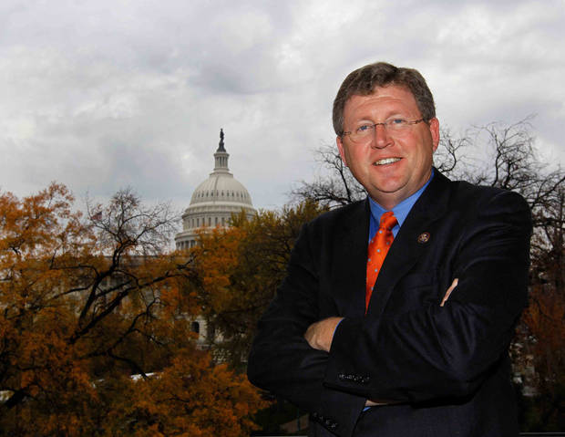 photo - FILE - Rep. Frank Lucas poses on a balcony outside the main hearing room for the House Agriculture Committee in the Longworth building on Capitol Hill in Washington, Tuesday, Nov. 16 ,2010.  (Photo/Ann Heisenfelt)