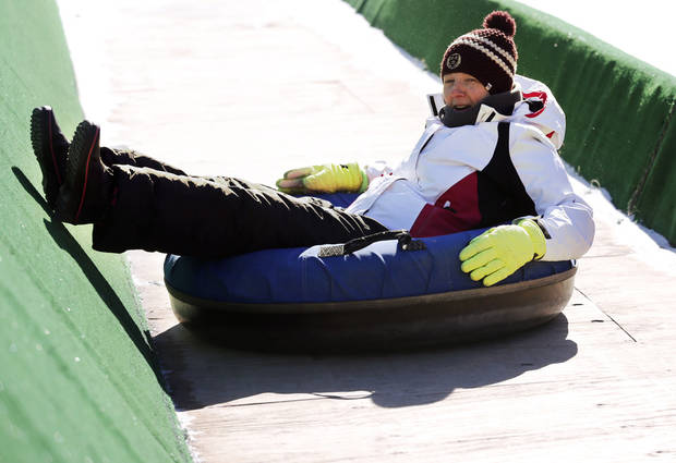 Dana Wallace slides at the Lifeshare Winterfest & Snow Tubing at the Chickasaw Bricktown Ballpark on Monday, Jan. 1, 2018 in Oklahoma City, Okla. Photo by Steve Sisney, The Oklahoman