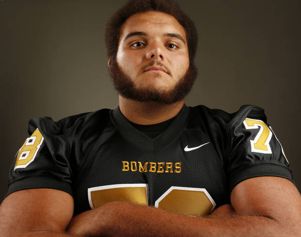 photo - HIGH SCHOOL FOOTBALL / MUG: Midwest City football player Carlos Freeman poses for a photo during The Oklahoman's Fall High School Sports Photo Day in Oklahoma City, Wednesday, Aug. 15, 2012. Photo by Nate Billings, The Oklahoman